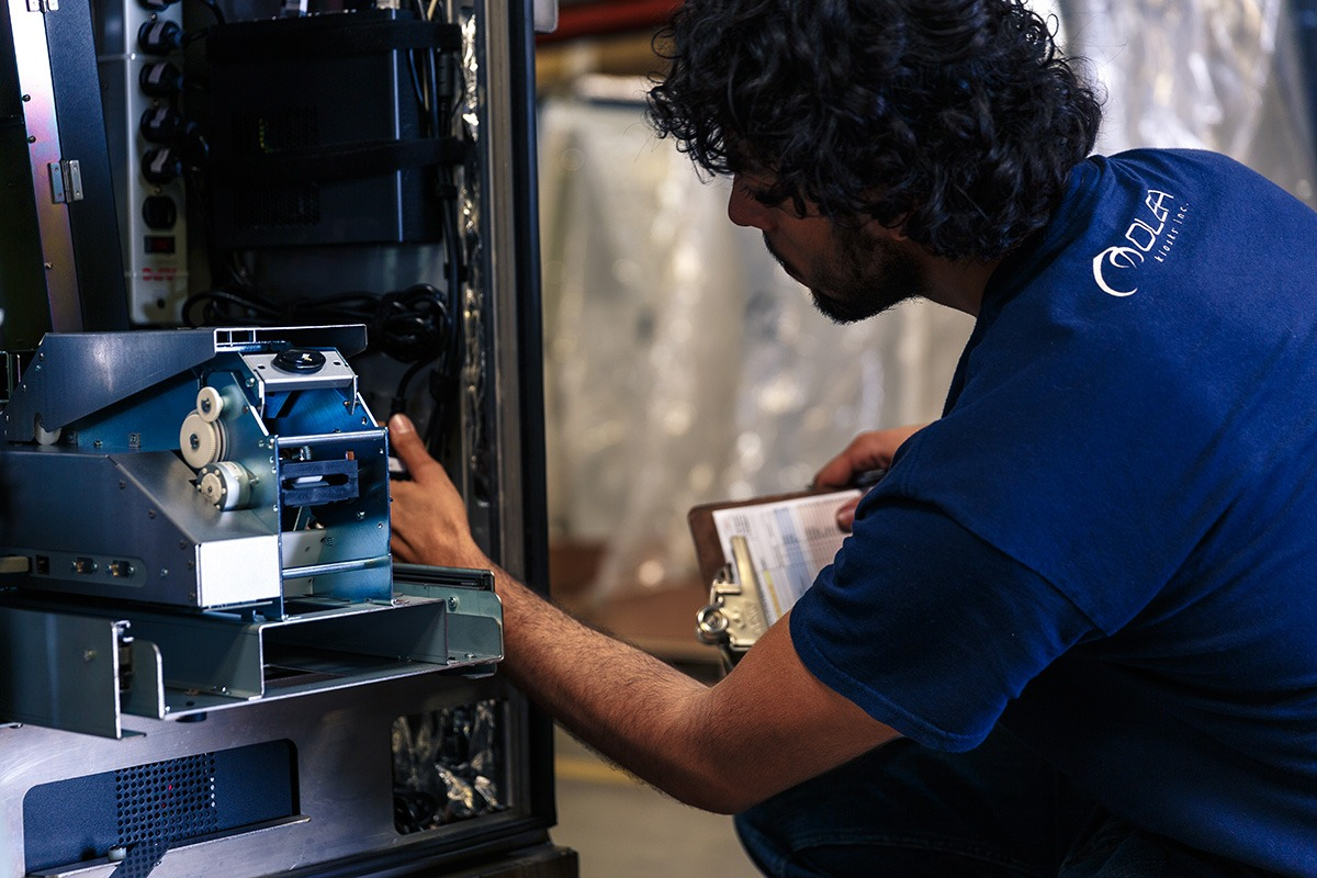 Employee Fixing a Kiosk at Olea