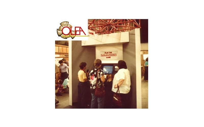 "Olea's first kiosk. Built in 1983 it featured a 20"" Television with a touchscreen overlay and was powered by a High Speed LaserDisc player. Olea built this for the State fair in CA."