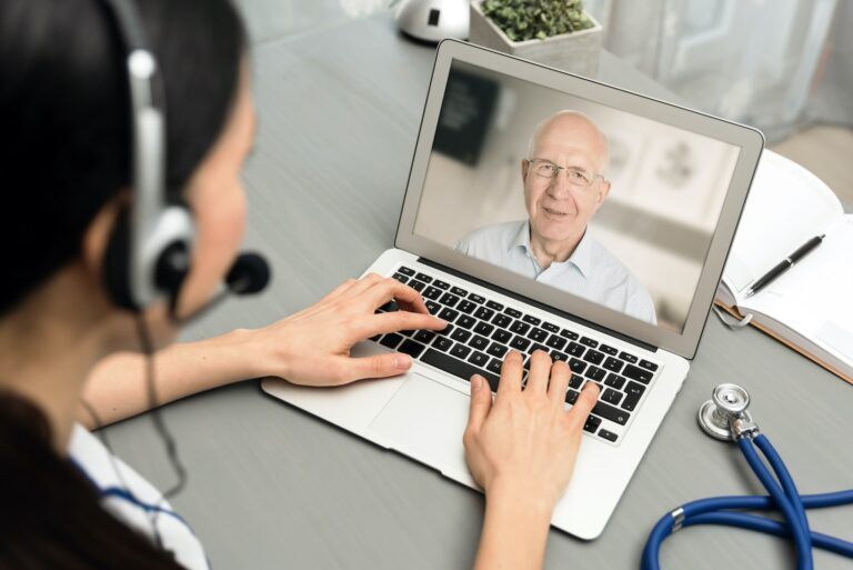 Doctor talking with a senior patient online